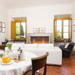 Nettuno vacation apartment dining living room